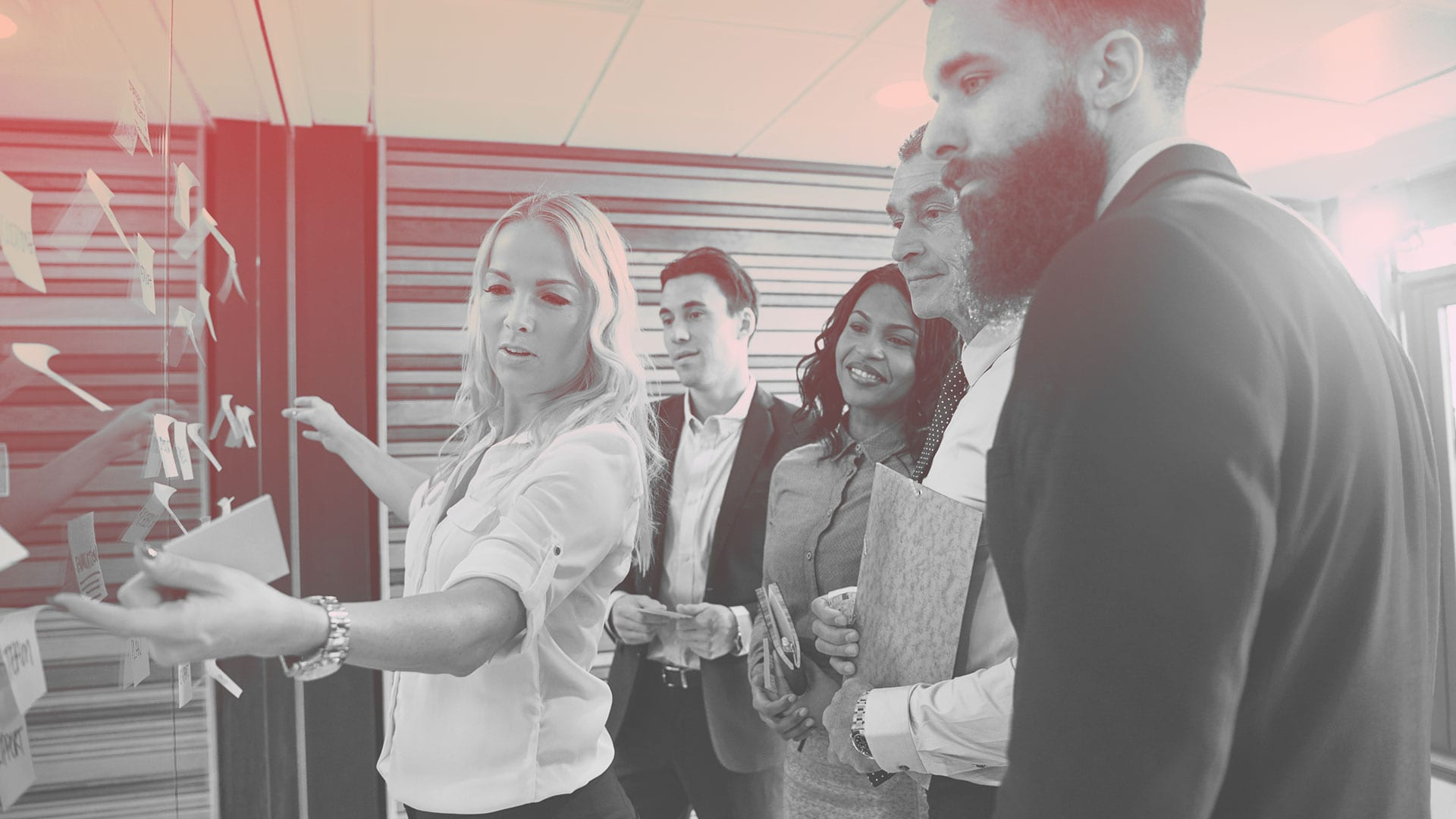 woman leading team during team meeting